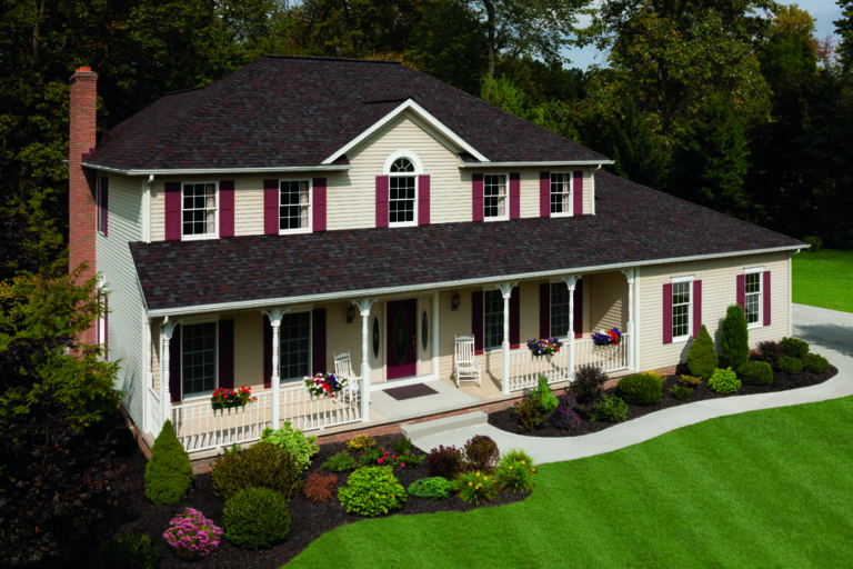Beautiful home with new Owens Corning Duration Merlot asphalt residential roofing system installed by the best residential roofing company near me.